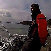 Cornish Shore and Kayak Fisherman